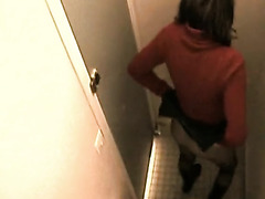 Hot brunette caught in the toilet