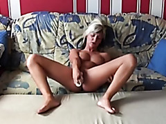 Jil masturbates with a sex toy hard