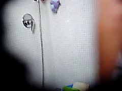 Masturbating with shower head in on voyeur cam