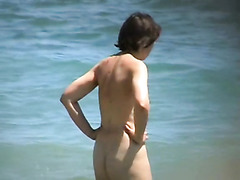 Nude mature takes a nice swim
