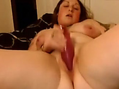 Large corpulent beauty enjoying her fake penis