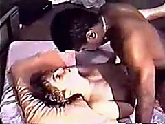 Interracial swinger wife enjoys a dark ramrod in one as well as the other holes