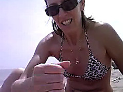 Perfect handjob on the public beach