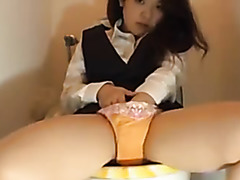 Cute Japanese Doll Masturbating on the Toilet