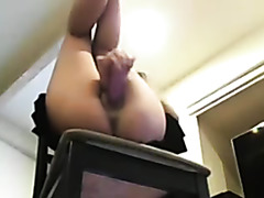 AN orgasmic babe uses dildo to get off.